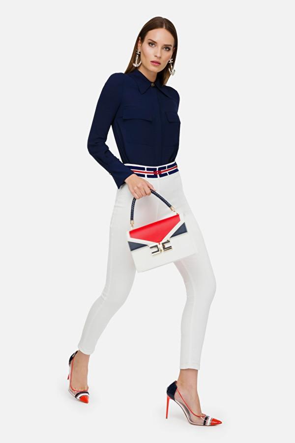 Pantalón denim blanco con cintura en contraste